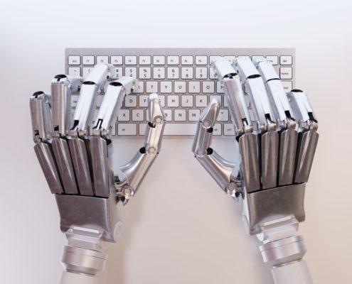 Robotic hands on keyboard 495x400 - Sourcing Advisory