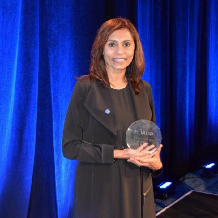 Avasant Foundation Executive Director, Chitra Rajeshwari displays her award as IAOP's Member of the Year